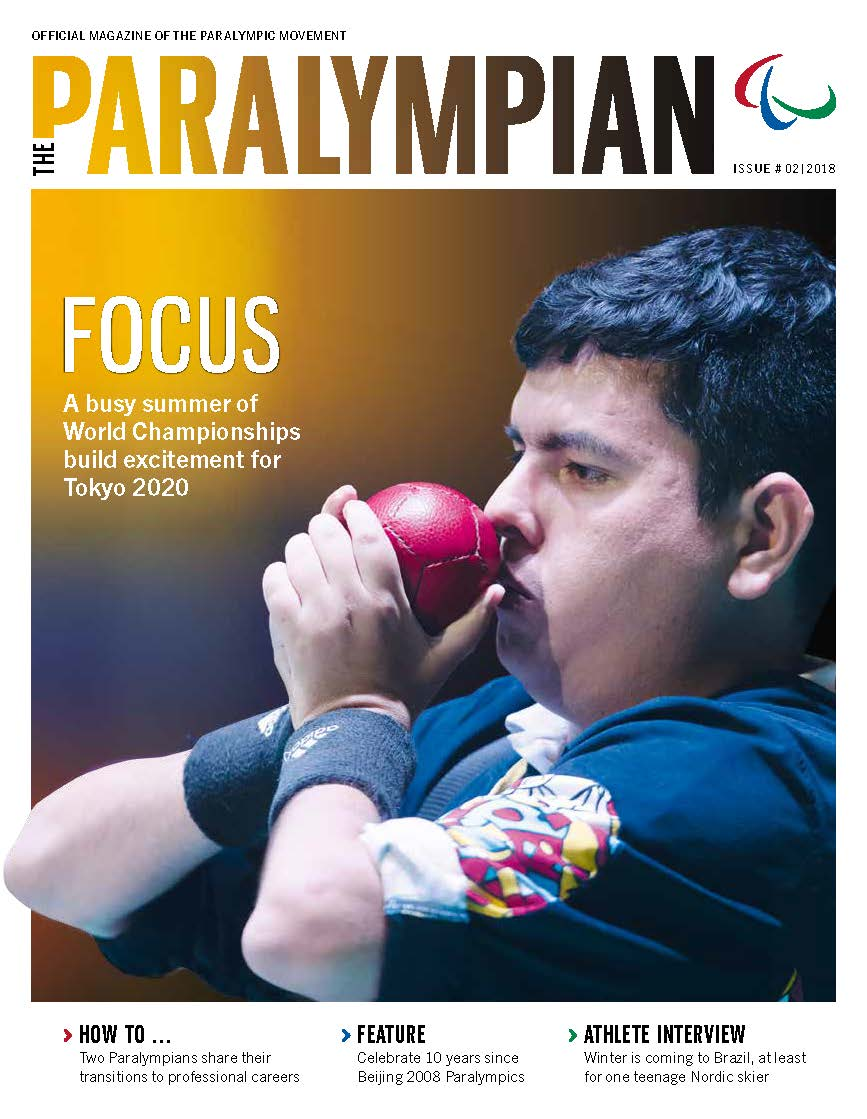 Magazine cover photo of Colombian athlete drawing a boccia ball to his face