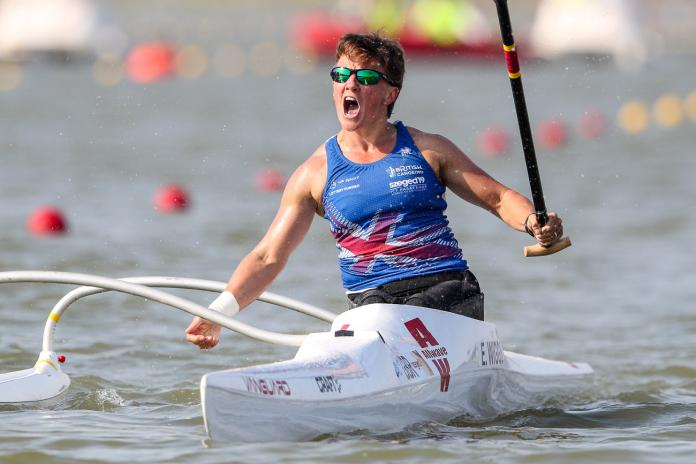 Woman in Va'a boat celebrating