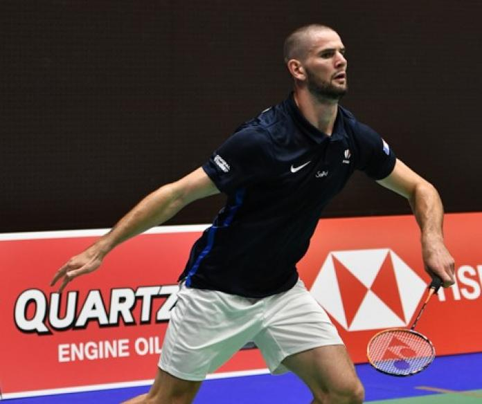 French badminton player about to rush for the birdie