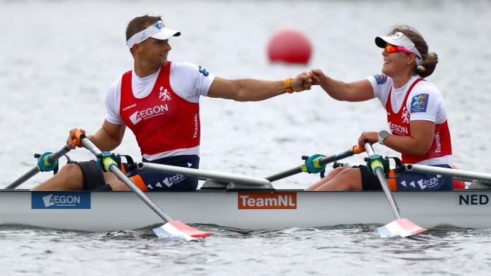 Dutch men's and women's rowing duo give each other a punch