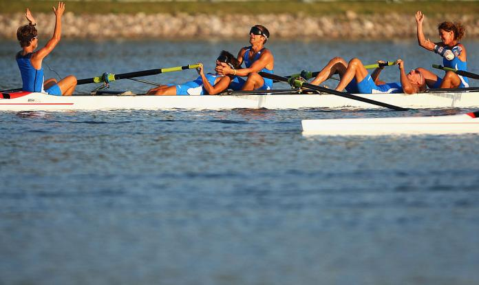 Italian coxed foursome celebrates exhaustion after winning gold
