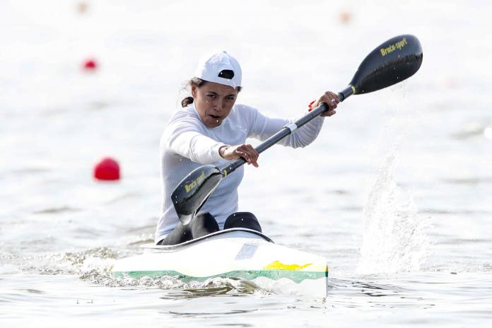 Woman paddling in canoe
