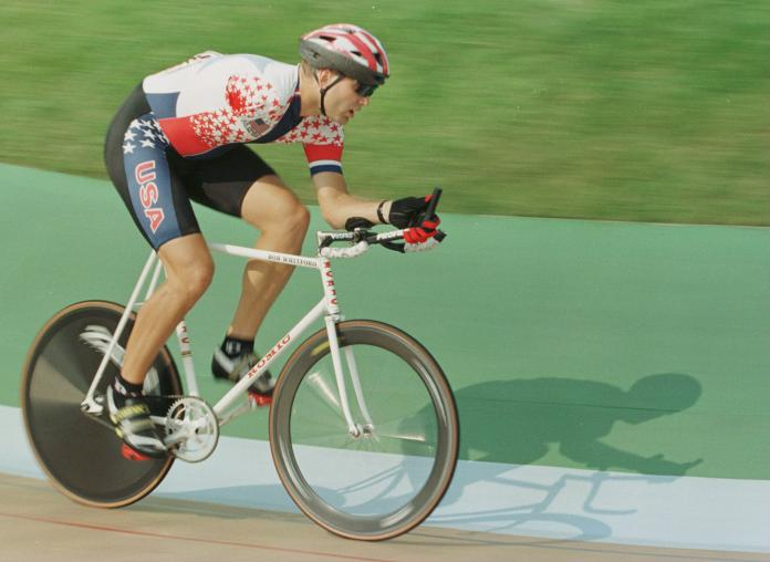 American cyclist with one arm competing on the track during the 1996 Atlanta Paralympics