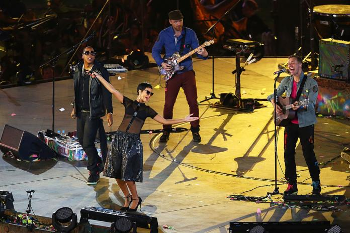 Three musical artists performing at the closing ceremony