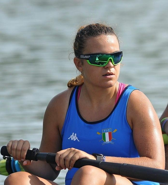 Female rower with sunglasses on the boat