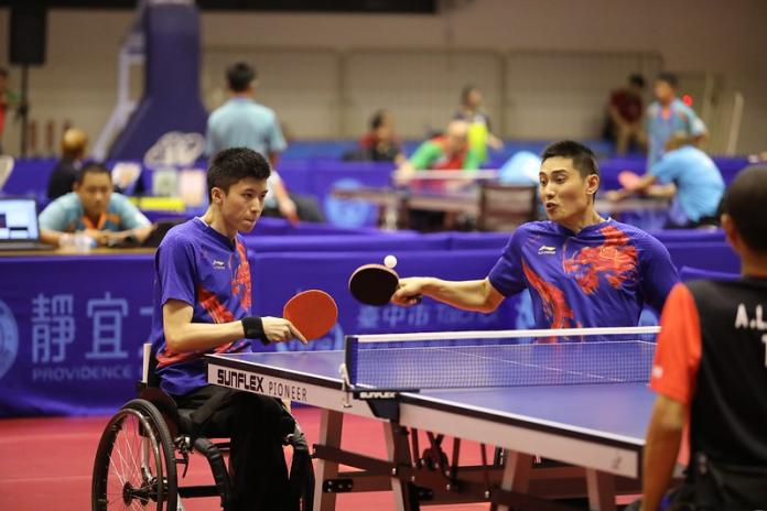 Two male Chinese table tennis players play doubles together