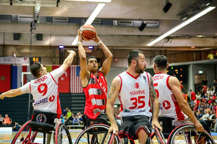 Iranian wheelchair basketball player Omid Hadiazhar defended by Turkish player