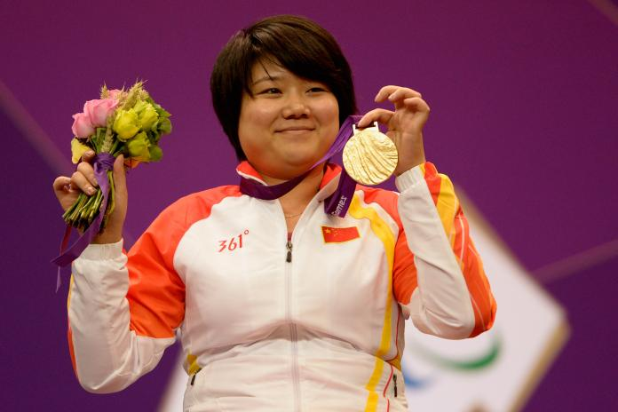 Zhang Cuiping celebrates with his gold medal