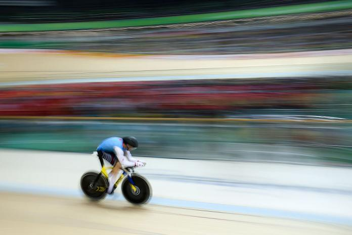 a paracyclist goes around the track