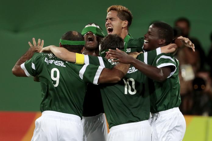 Five Brazilian blind soccer players celebrating