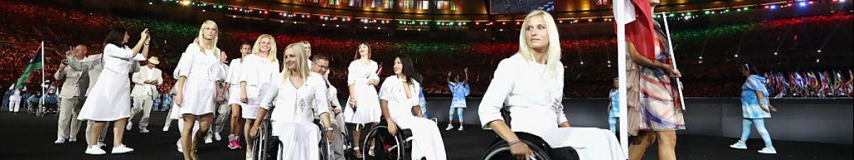 a group of Para athletes walking at an opening ceremony