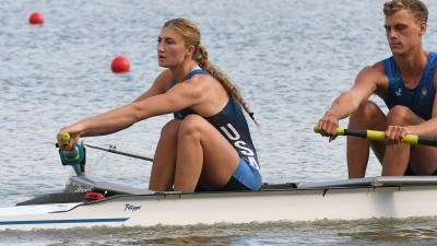 Woman in rowing boat strokes