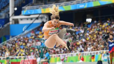 A female Para athlete competing in the long jump