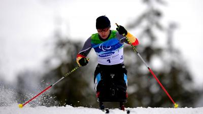 A woman in the wheelchair at the biathlon track