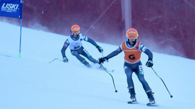 a male Para skier and his guide