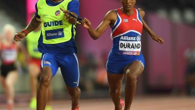Omara Durand of Cuba crosses the line to win the Women's 100m T12 Final at the London 2017 World Para Athletics Championships.