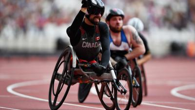 Brent Lakatos of Canada crosses the line to win in the Mens 100m T53 final at the London 2017 Para Athletics Championships.