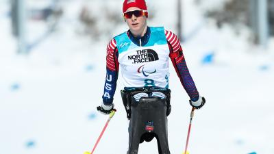 a female Para Nordic skier in the snow