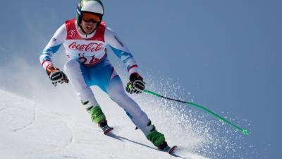 a male standing Para alpine skier in action