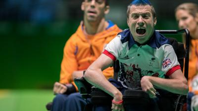 male boccia player David Smith celebrates after throwing the ball