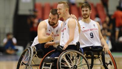 male wheelchair basketball player Gregg Warburton being hugged by a teammate
