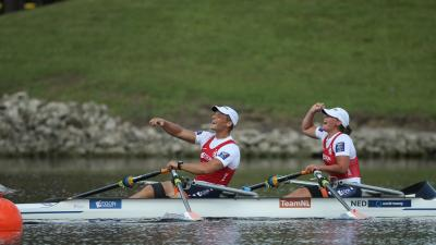 female and male Para rower Annika van der Meer and Corne de Koning celebrate in their boat