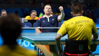 male Para table tennis player Fabien Lamirault punches the air after a shot