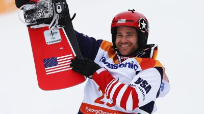 male Para snowboarder Mike Schultz holding up his snowboard