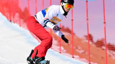 A female Para snowboarder competing