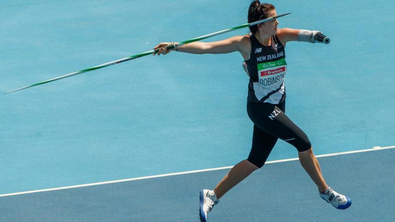 a female athlete with one arm prepares to throw a javelin