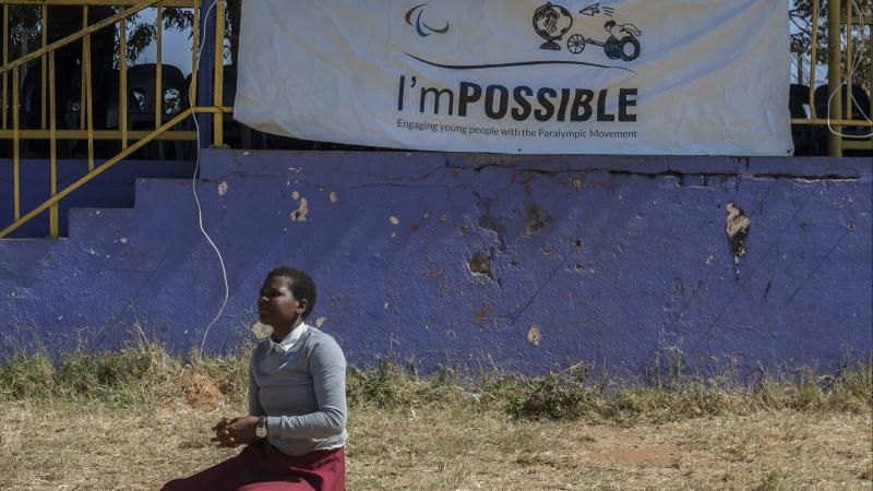 Girl play sitting volleyball during I'mPOSSIBLE event in Malawi