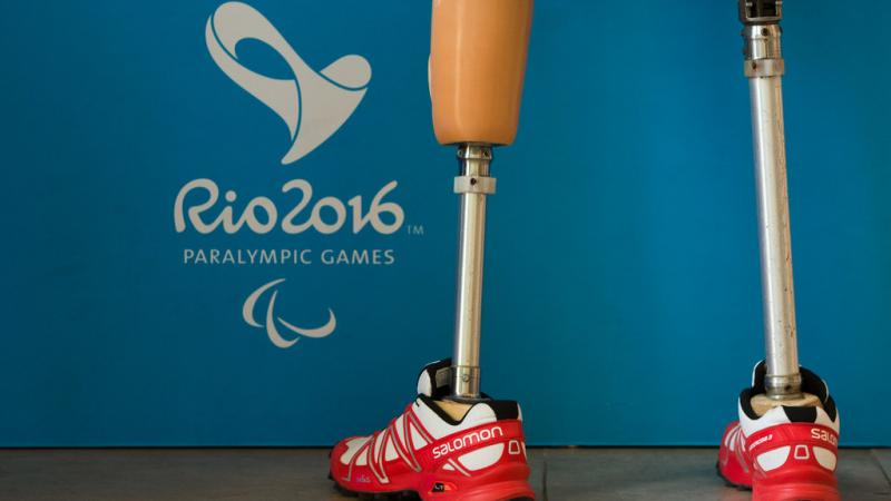 a pair of prosthetic legs next to the Rio 2016 emblem