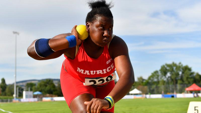 Teenage Mauritian female athlete prepares to release shot put