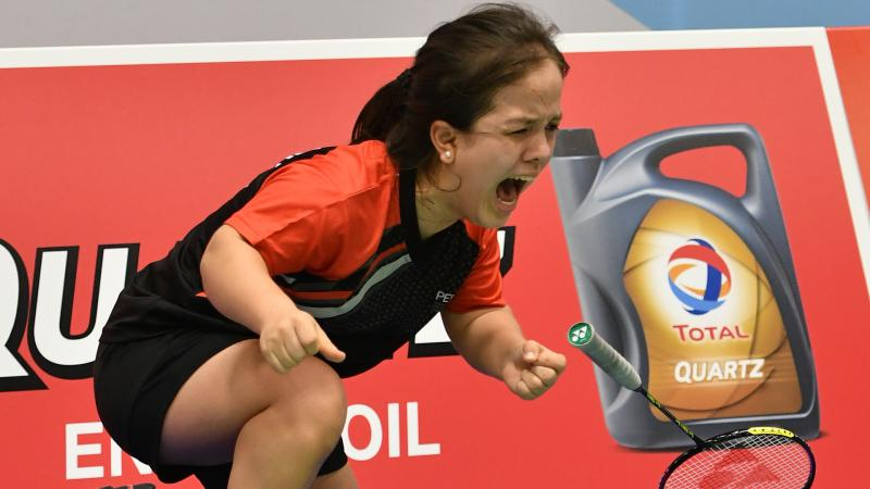Female short statured woman screams in celebration after winning a World Championship title
