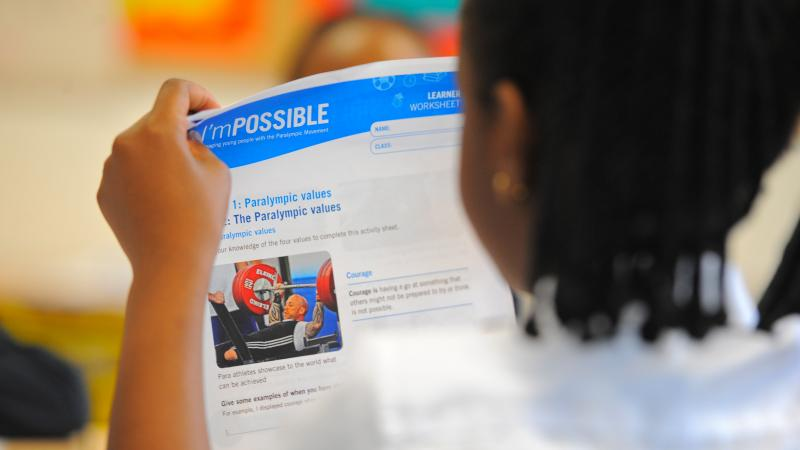 Learner reads I'mPOSSIBLE toolkit about the Paralympic values