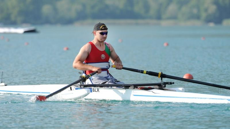 Man sits in rowing boat