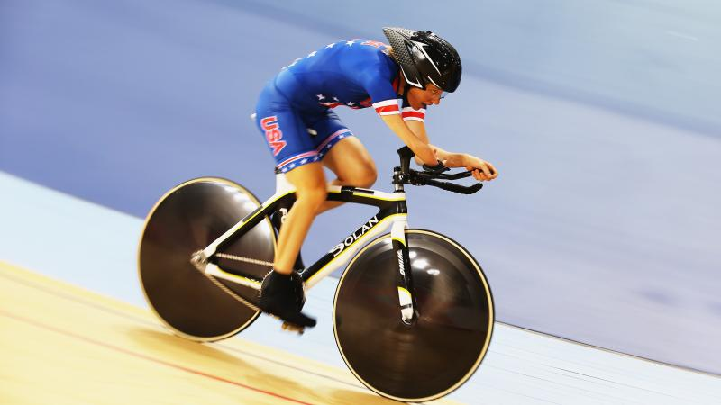 Woman riding track bike in velodrome