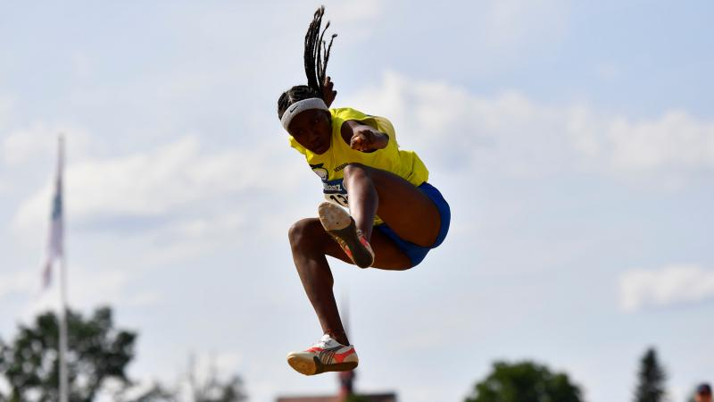 Ecuadorian athlete Kiara Rodriguez flies in the air after her jump