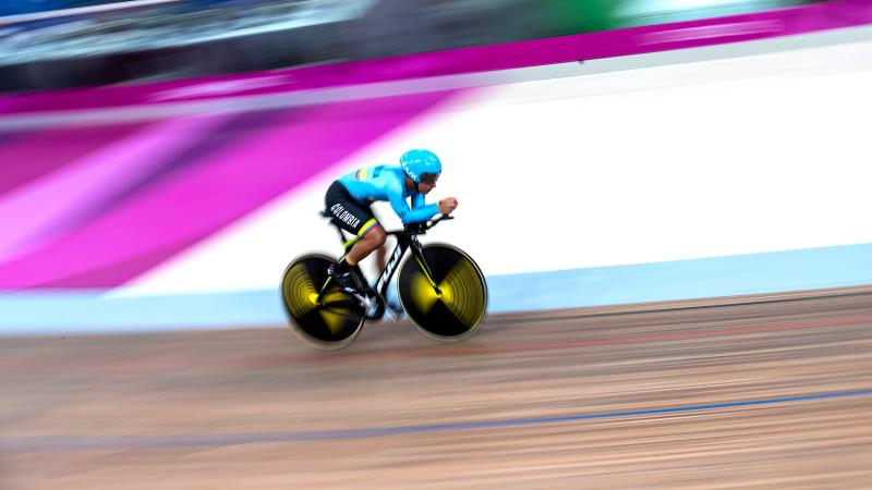 a male Para cyclist on the track