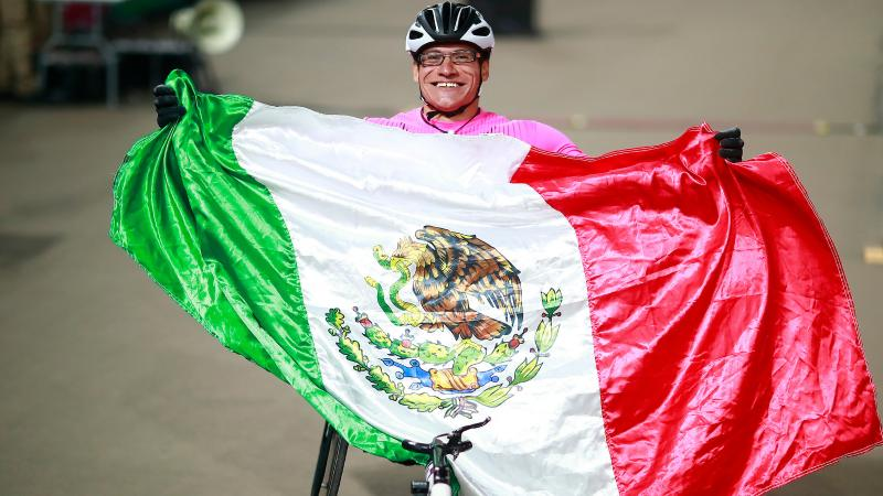 male wheelchair athlete wrapped in a Mexico flag