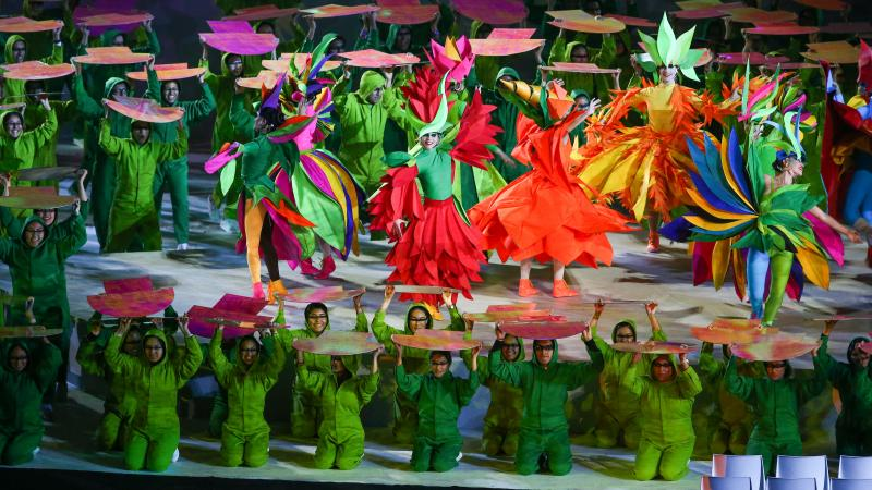 dancers in rainbow colours on a stage