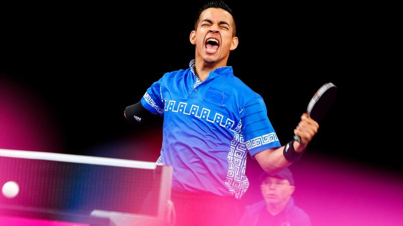 a male Para table tennis player celebrates