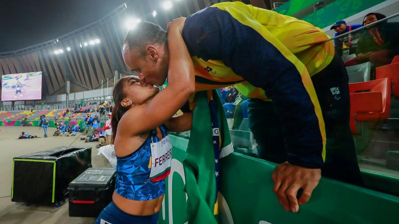 two Para athletes kissing