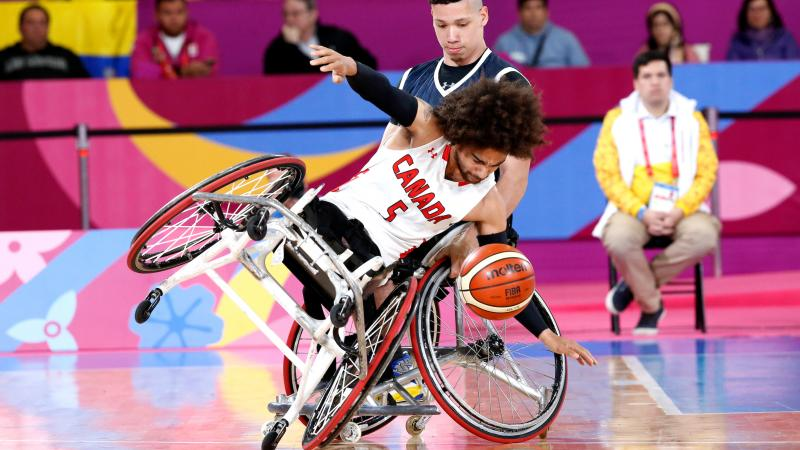male wheelchair basketball player tipping over