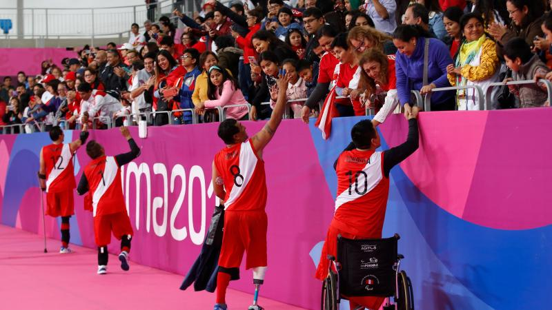 Peruvian sitting volleyball players cheered by the crowd