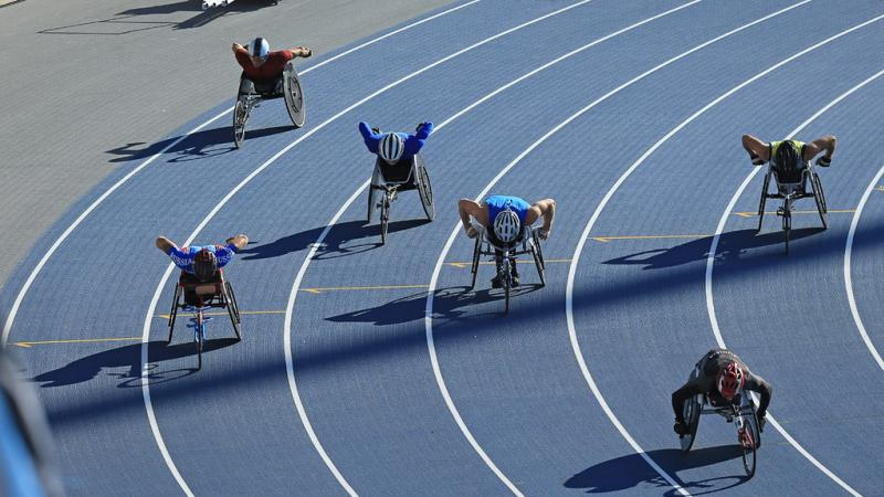male wheelchair athletes going round the bend of the track