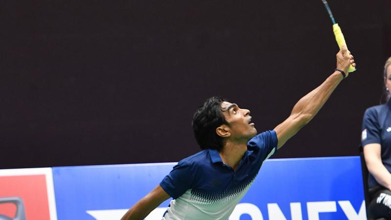 Indian badminton player reaches for a shot
