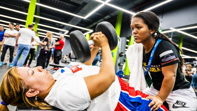 Powerlifting athlete and coach from Venezuela practice during Agitos Foundation workshop in Nur-Sultan