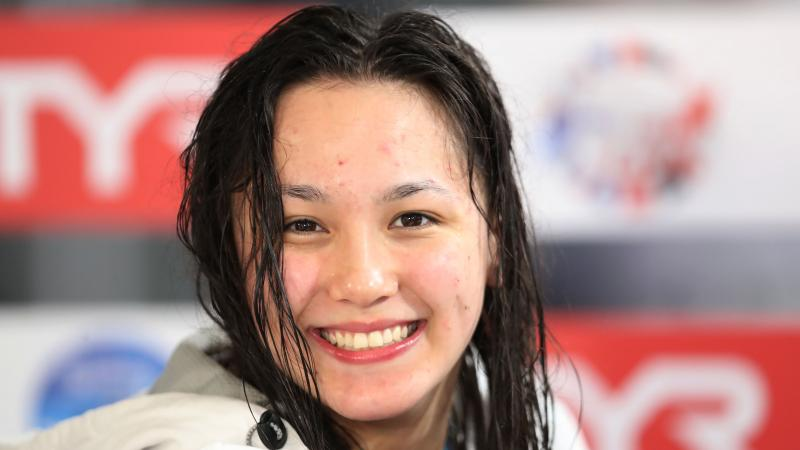 a female Para swimmer smiling