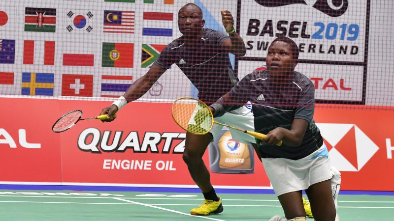 Doubles Ugandan badminton team on the court